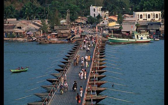 Old floating bridge in HaTien town - mekong delta tour