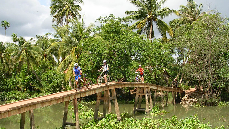Over village bridge - Mekong delta cycling tour to Caibe