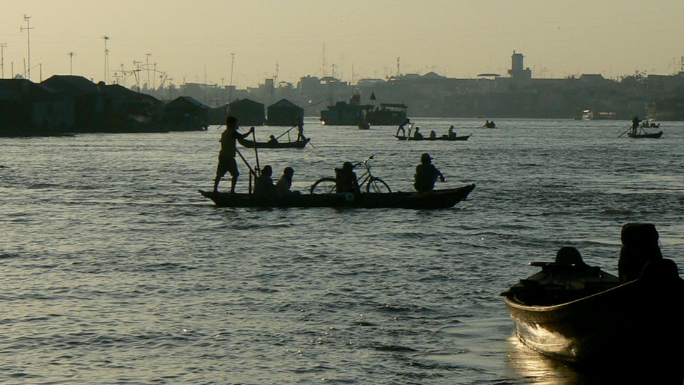 Mekong river cruise - small sampan ferry at ChauDoc market