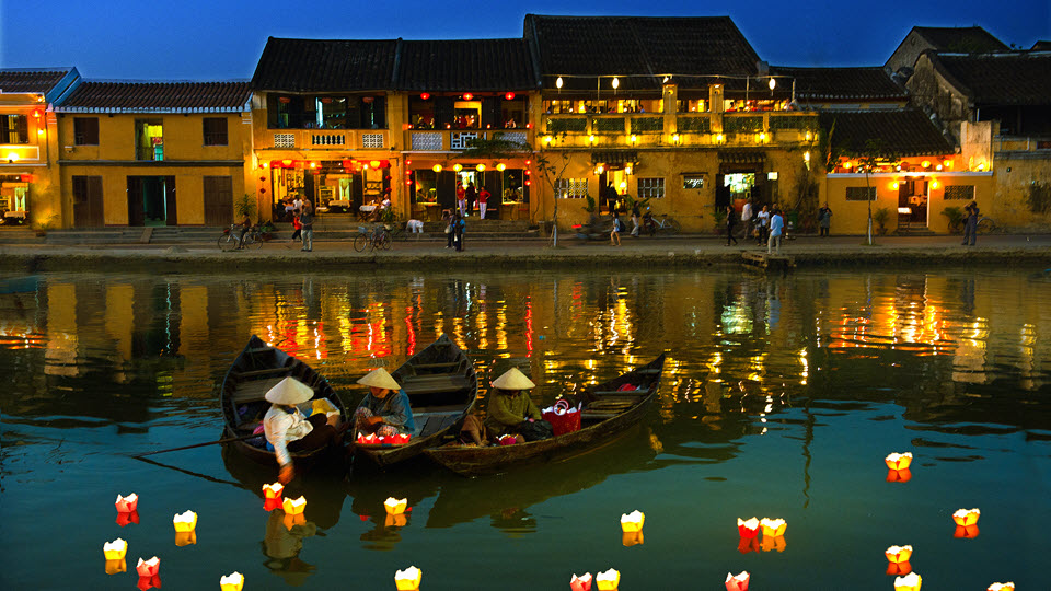Lanterns on Hoi an river in full moon night - Hoi an tour