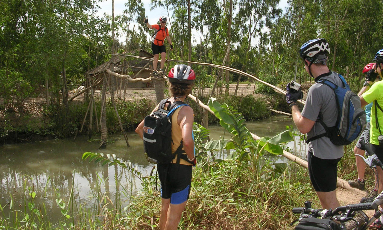 Mekong delta cycling tours - local monkey bridge