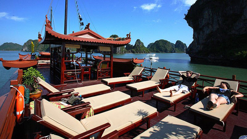 Halong bay cruise - relaxing on sun deck of Phoenix cruise