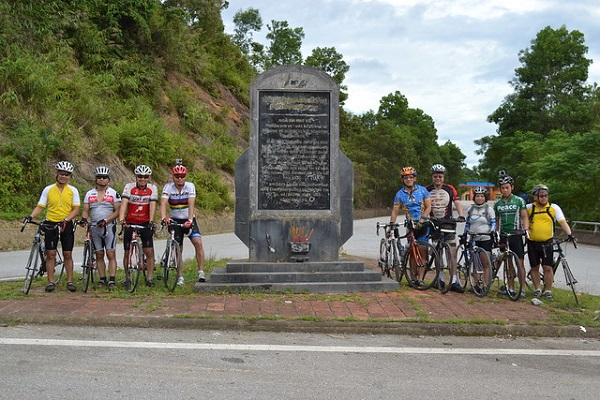 Group of cyclist from Australia and  America at Khe Ve intersection